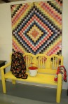 Hwy 41 yellow bench & quilt