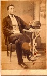 Scot man sitting, striped pants, G Adams, Brora