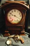 Mantle clock, Bulldog pistol and pocket watch passed down from James Frank Bowie.