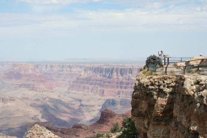 grand canyon wally on rim waving
