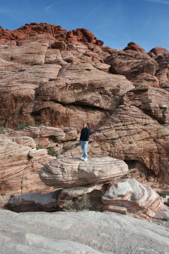 red rock, jamie standing on rock vert