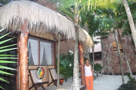 Lucia and hut, Ka'an wall