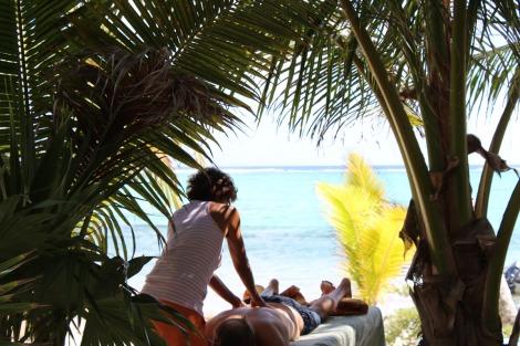 Lucia massaging wally, beach