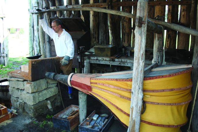 blacksmith working bellows