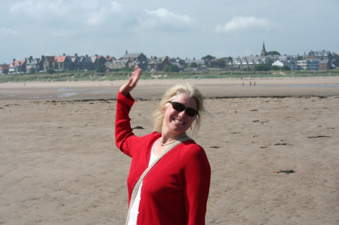 eng-jamie waving on alnmouth beach