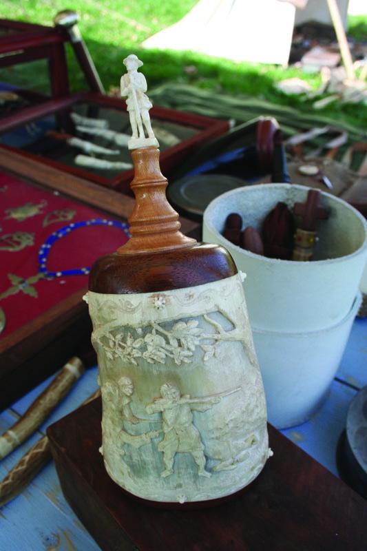 manskers, carved horn