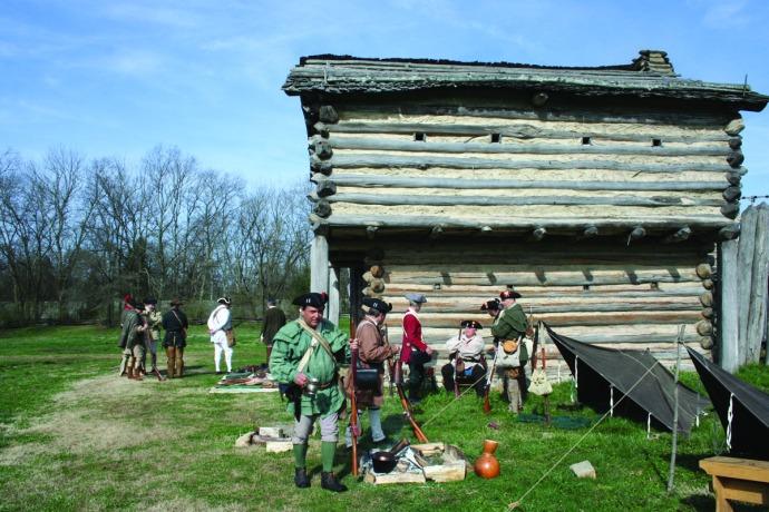 manskers, men gathered outside fort