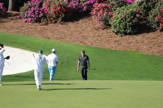 Masters black shirt, blue pants