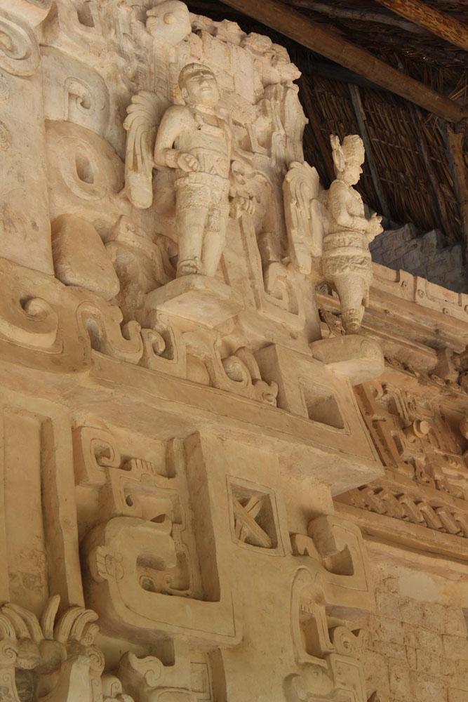 Ek Balam tomb winged figures side view