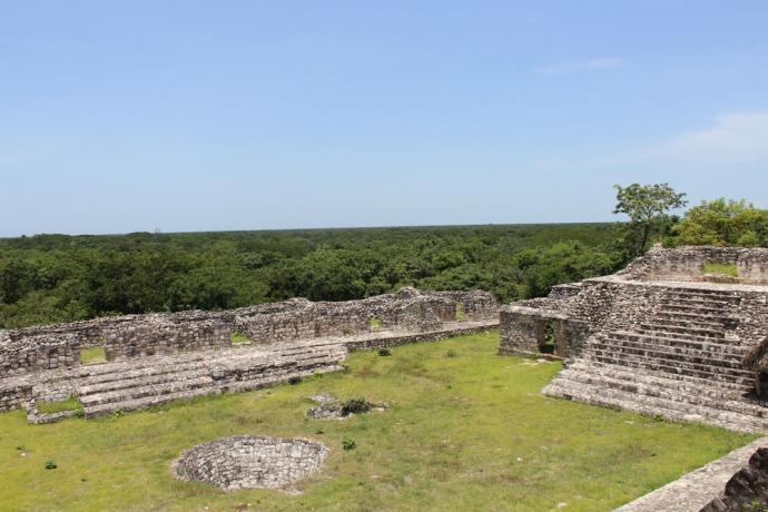 Ek Balam well and courtyard below temple