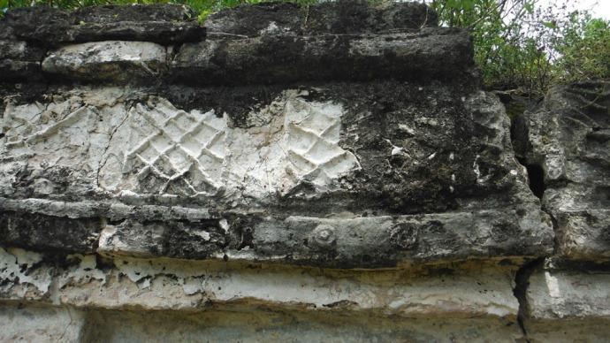 Sian Ka'an carving on custom house
