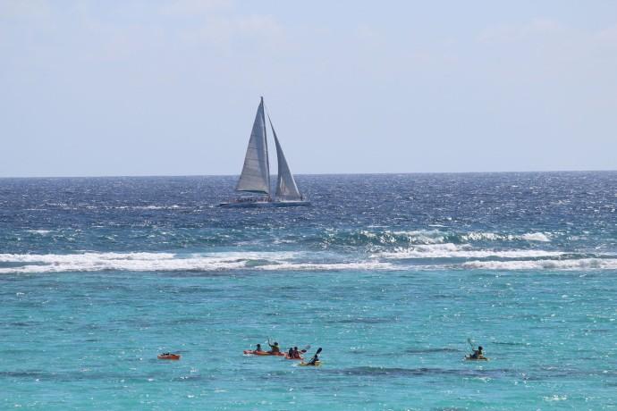 Soliman Bay kayakers, sailboat 2