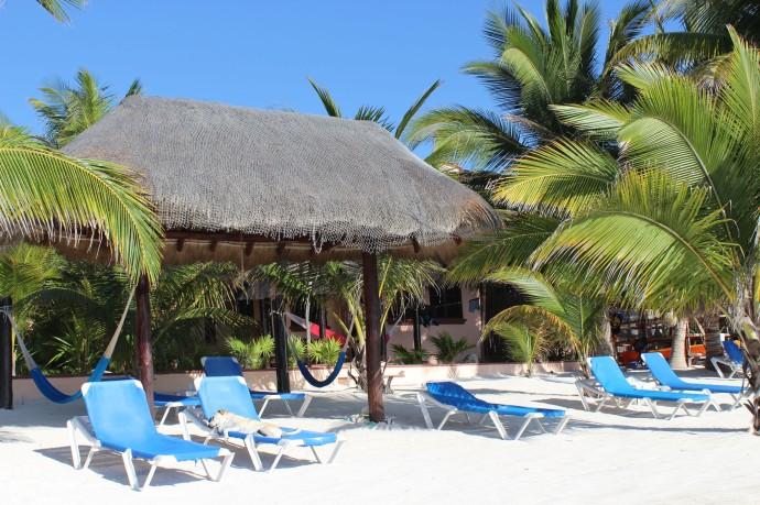 Nah Uxibal palapa, chaises, blue sky