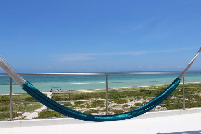 Rio Lagartos beach rooftop hammock