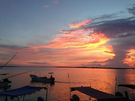 Rio Lagartos sunset fisherman headed in