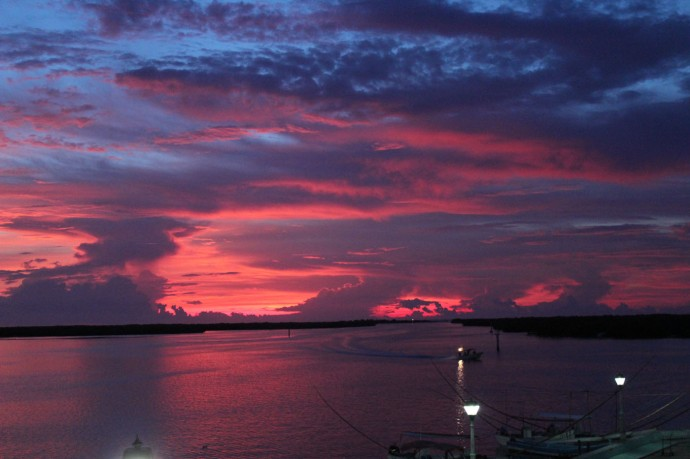 Rio Lagartos sunset, red bay, blue in sky