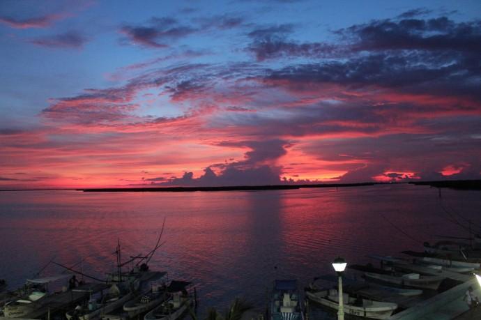 Rio Lagartos sunset town in front
