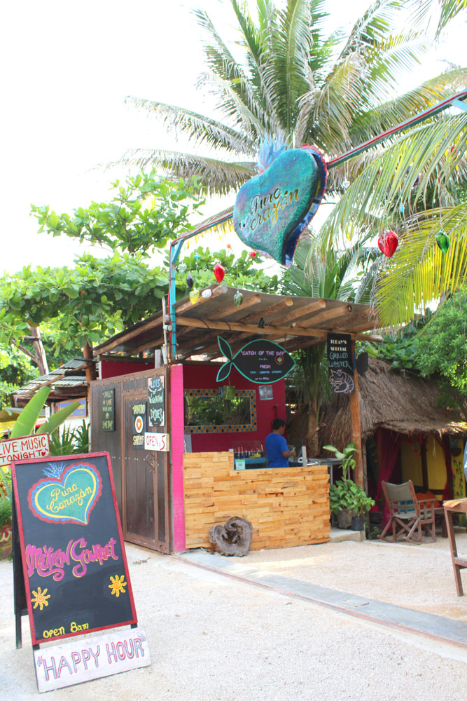 Tulum Beach Pura Corazon entrance, signs