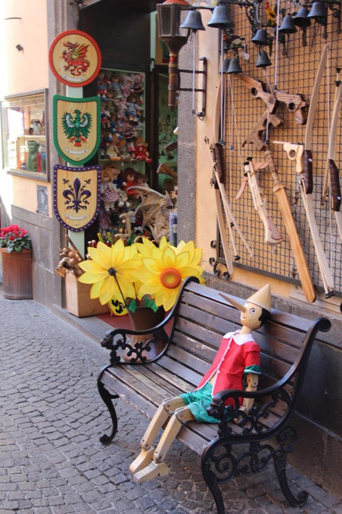 Orvieto pinocchio on bench