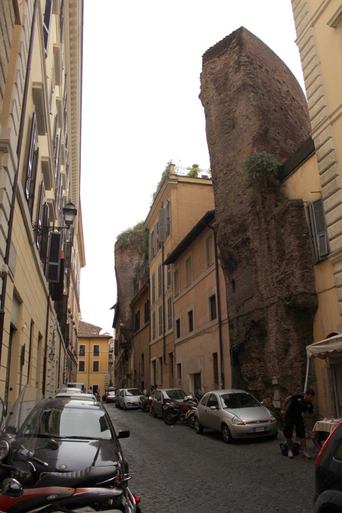 Rome alley with roman wall ruin