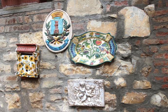 Castiglione del Lago ceramic plaques on wall