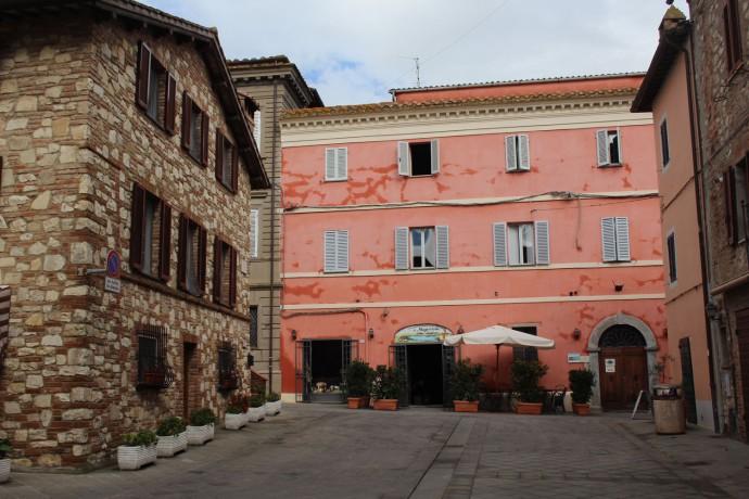 Castiglione del Lago peach and stone bldg