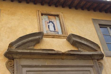 Castiglione del Lago saint over door arch