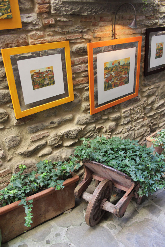 Cortona Il Pozzo paintings & wheelbarrow