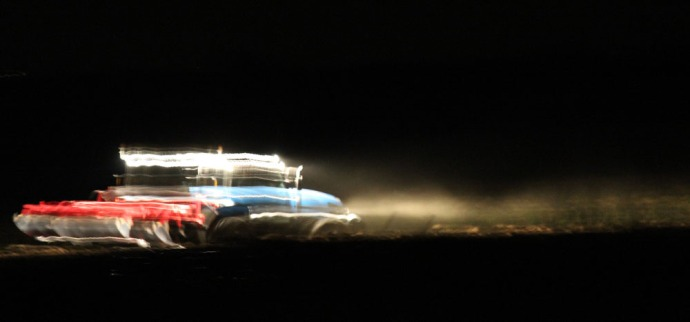 Cortona tractor in motion at night