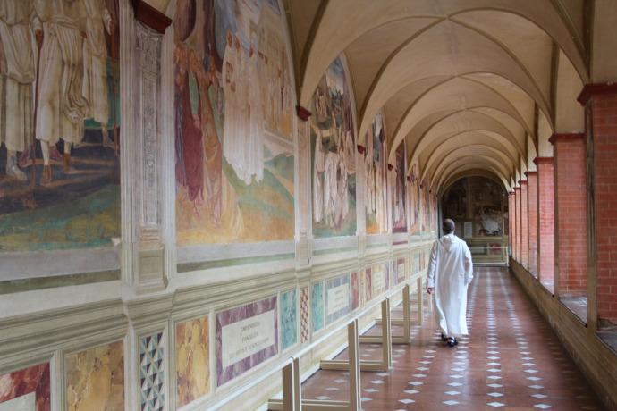 Monte Oliveto monk walking down hall