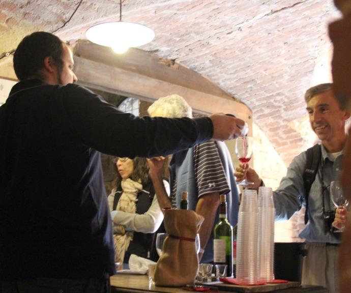 Monte Oliveto pouring wine for tasting
