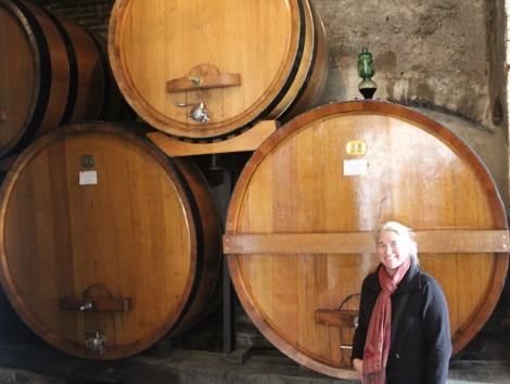 Montepulciano Contucci Jamie with wine barrels