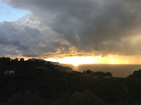 Erca view to Capri, sun & storm clouds