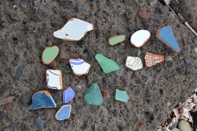 Massa tile pieces on beach