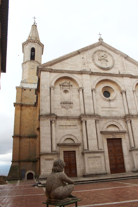 Pienza church and sitting sculpture