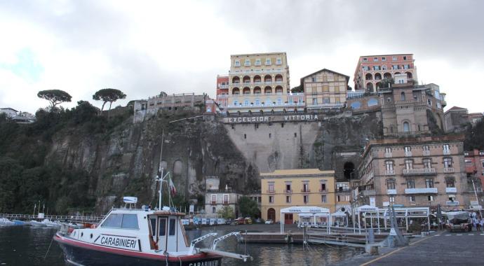 Sorrento Excelsior Vittoria hotel on cliff, boat