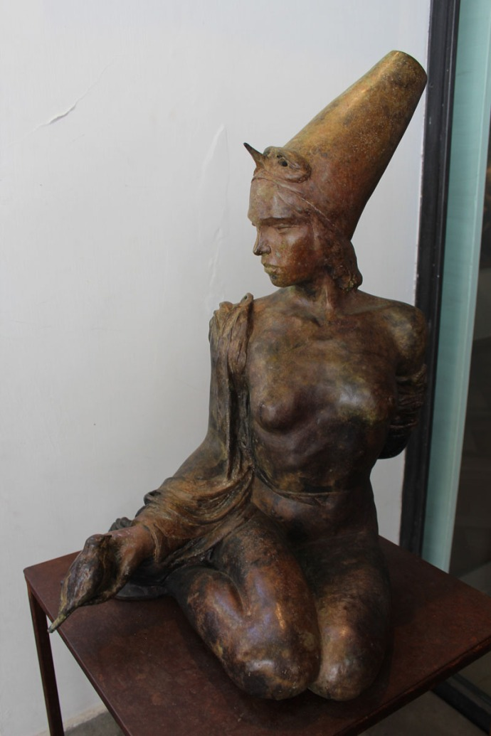 Positano art gallery cone hat lady sculpture