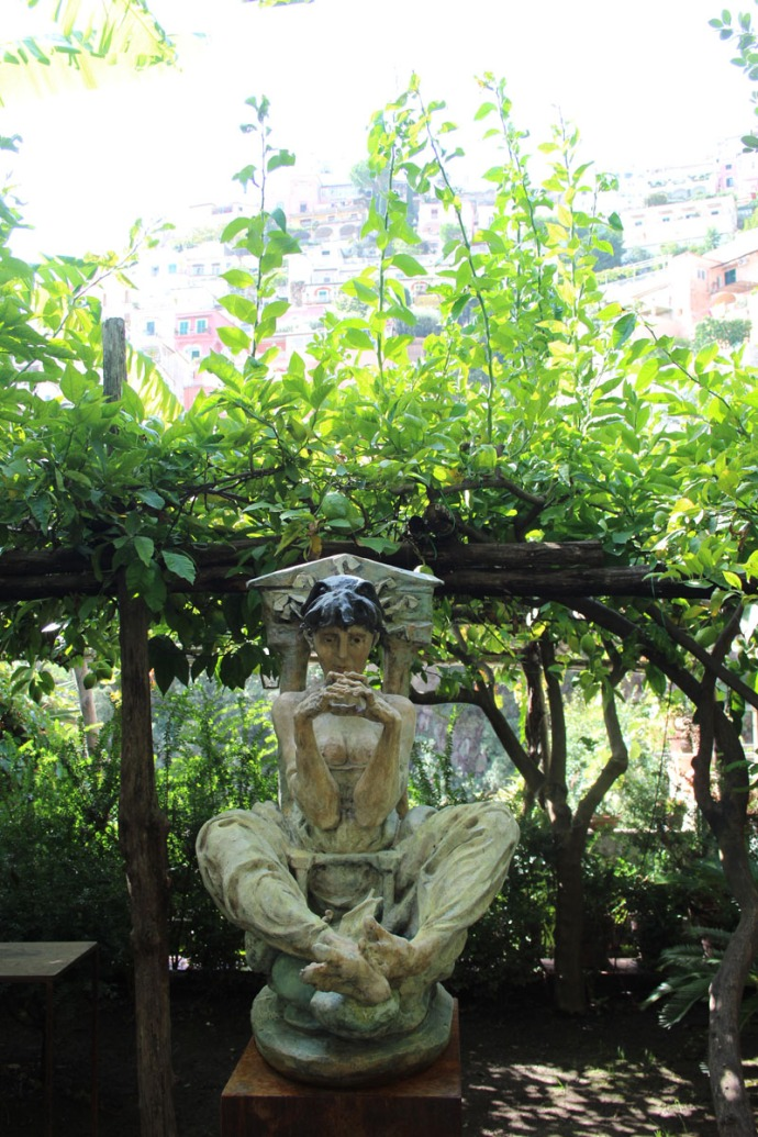 Positano art gallery lady sculpture in garden