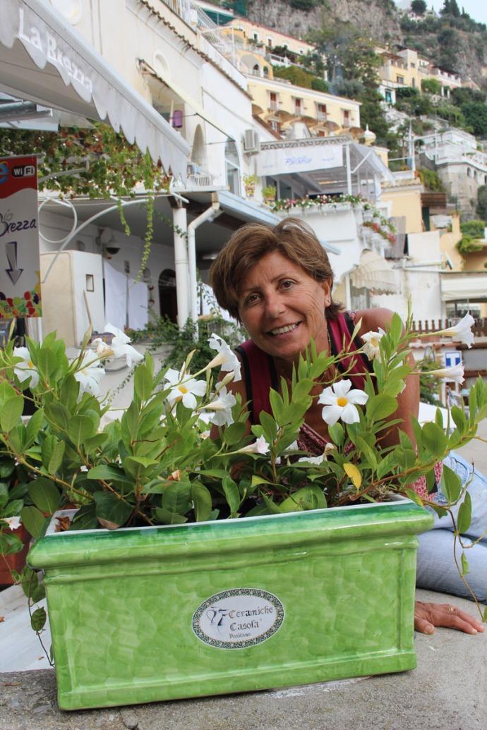 Positano La Brezza Lucia smiling thru flowers