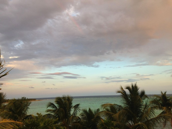 Soliman Bay View, rainbow in clouds