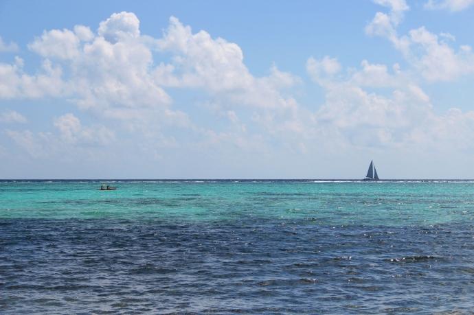 Soliman kayakers and sailboat