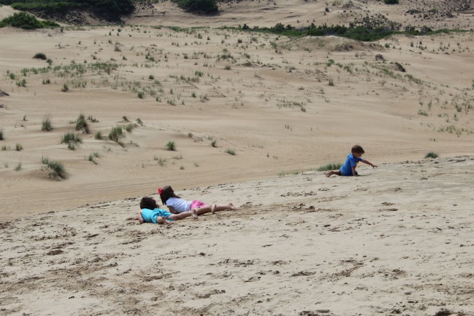 Jockey Ridge girls and boy playing