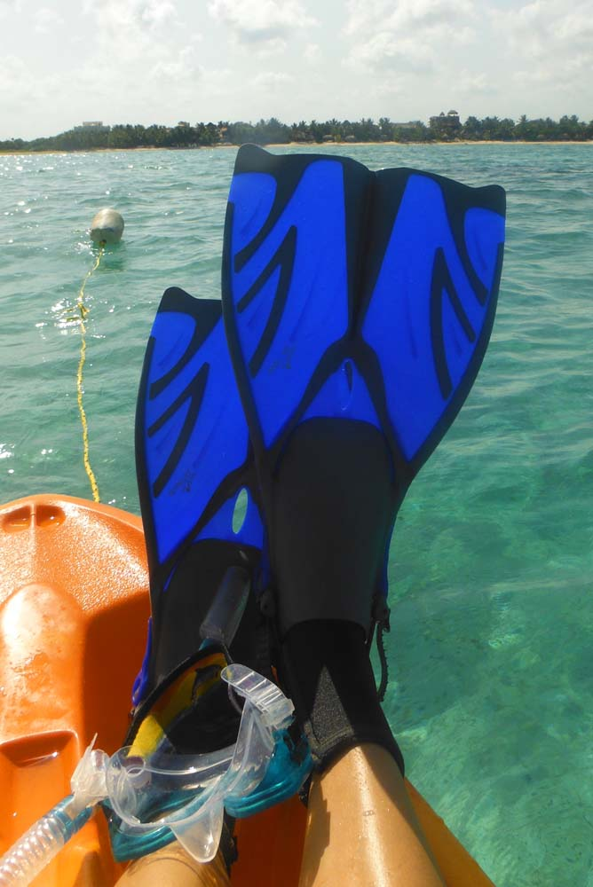 blue flippers on kayak