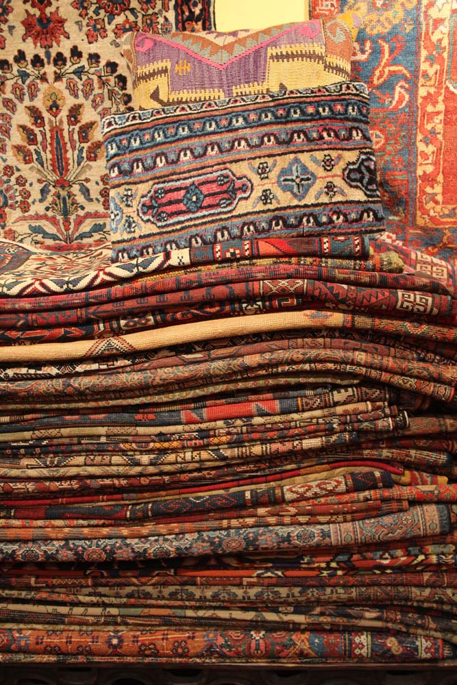Philly Woven Treasures stack of rugs