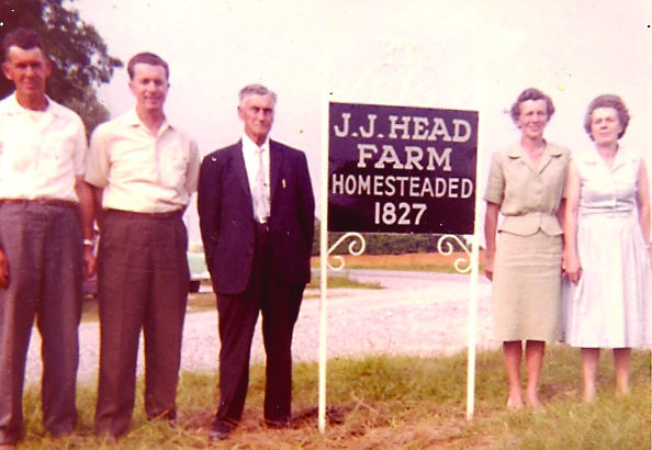 Jj head farm sign, heads